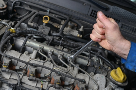 24976367 - auto mechanic is working on engine in car repair shop